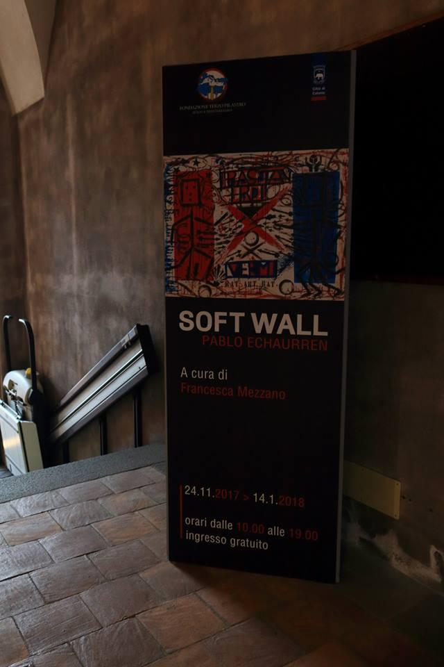 """La locandina della mostra """"Soft Wall"""" di Pablo Echaurren a Palazzo Platamone"""